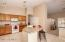 Kitchen flows to the Family Room.
