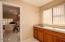 Sunny Laundry Room with cabinets, sink & folding counter.