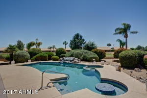 Back yard oasis with pool and spa overlooking the golf course