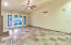 Great room has travertine and vaulted ceilings, and FP
