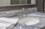CLOSE -UP OF MARBLE COUNTERS, NEW FIXTURES
