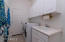 Laundry w/cabinets & utility sink