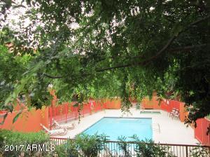 Refreshing community pool & spa. Located steps away from the property.