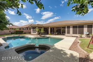 Outstanding oversized backyard complete with pool and spa.