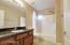 Hall bath with custom cabinetry