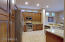 Upgraded kitchen with granite counters and custom cabinetry