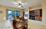 Spacious great room with custom built in cabinetry