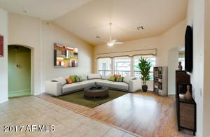 Living Room - Spacious with views of gorgeous resort like backyard through windows.
