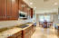 Custom designed kitchen includes upgrade granite counters, cook top, raised convection oven, large refrigerator and upgrade dishwasher all thoughtfully located to make your kitchen cooking experience a delight