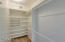 Walk-in master closet is double racked and includes shelving for shoes, hats and clothing accessories. There are two other closets in master for additional clothing and personal use if needed.