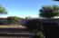 Fenced backyard desert landscaping south facing