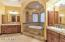 His and hers vanities, closets, walk in shower, and look at that tub!