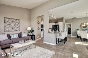 Great open concept living. Tile in main living areas. Photo represents a model home.