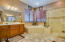 This Master Bath has Twin Sinks as well as Separate Glass Shower and Garden Tub