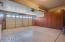 This Garage is Meticulous with Epoxy Floor and Floor to Ceiling Storage Cabinets on 2 Walls