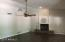 View of family room, fireplace, and pot shelves with fresh gray paint