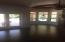Family Dining Room, Family Room, and French Doors to Massive North Patio