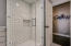 Secondary Bathroom with Subway Tile, Hexagonal Mosaic Flooring and Walk In Glass Shower.