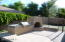 BUILT IN GAS BBQ WITH TILE COUNTER SPACE, GAS FIREPLACE AND TILE COVERED BENCH SEATING.