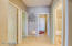 Spacious hallway to additional bedrooms, laundry room and second bathroom
