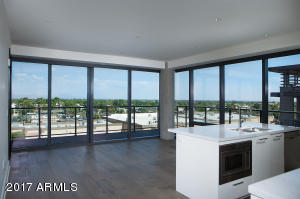 Kitchen overlooking great room and spectacular views thru floor to ceiling glass of corner unit.