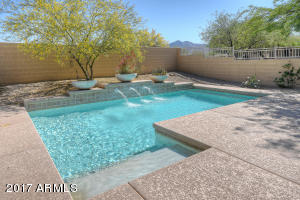 Nice water feature in pool. Mountain views!