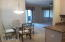 View of formal dining into living room