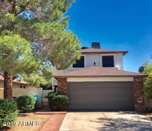 Nice curb appeal with a freshly painted exterior and a large shade tree