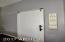 Barn door separates master bedroom and bath space