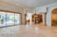 Great Room/Family Room with disappearing wall of glass, surround sound, cantera stone pillars and fireplace, built in entertainment center/desk area and tray ceilings with a spectacular view!