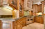 Kitchen with Custom Cabinetry, Viking Appliances - including 6 burner gas range with double ovens.