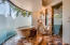 Master Bathroom featuring mini-fridge, jetted soaking tub, his/her vanities, private water closet with bidet, spectacular glass work, walk in shower and separate sauna/steam room.