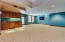 Basement Media Room and Game Room with Wet Bar and Surround Sound System.