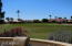 Beautiful green grass views as far as you can see from your patio with knee wall and decorate wrought iron fencing