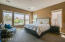 Expansive master bedroom with 5 dual-pane low e windows.