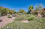 Premium lot features expansive desert landscaped green belt.