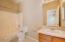 Plenty of room to add a vanity mirror or makeup desk