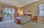 large master bedroom with sliding glass doors to patio
