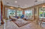 great room surrounded by windows with views of the golf course