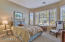 large guest bedroom with bay window