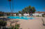 Your community pool has a very nicely done privacy fence and landscaping. It's a pleasant place to hang out.