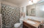 Your guest bath has an updated vanity, mirror and lighting. It's fresh and clean.