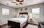 Upstairs bedroom. Ceiling fan. Wood flooring.