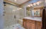 Separate dual sinks and oversized walk-in shower master bath.