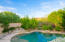 Pebble finish pool with view fencing looking out to desert wash area / mountain views.