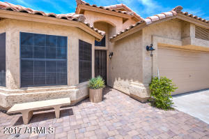 Large extended paver patio adds character and panache