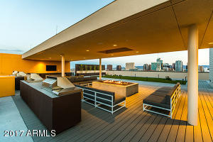 Roof top lounge area with Bbqs, fire pits and tables to enjoy an evening.
