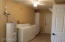 Washer and Dryer Stay, This Laundry Room is a Heated and Cooled and even has a Ceiling Fan.