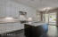 Chef's Kitchen w/ White Shaker Style Cabinetry w/ contrasted Espresso Island, Stainless Steel Jenn-Air Appliance Package (2 Dishwashers, 6 Burner Gas Cooktop, Double Ovens) and TONS of Lighting.