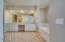 Master Bedroom Suite - Bathroom with Walk In Marble Shower and Soaking Tub, Granite Countertops and Tile Laid in Herringbone Pattern.